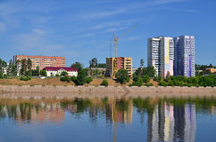 Block of flats and buildings on river bank Royalty Free Stock Image