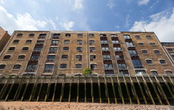 Block of flats in Docklands. London. UK. Old dock converted to block of flats in Docklands. London. UK Stock Photos