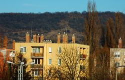 Block of flats in front of a mountain. stock images
