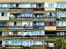 The facade of a dilapidated post-communist block of flats in Kyiv, Ukraine royalty free stock photography