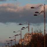 Block of flats and light poles at sunrise Stock Photography