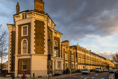 Block of flats in London at sunset. Block of flats in london at a corner during the sunset giving a very warm colors in a overcast day Stock Photo
