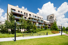 Block of flats with public green area around. Newly built block of flats with public green area around Stock Photography