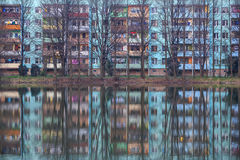 Block of flats reflection in the water with trees Royalty Free Stock Image