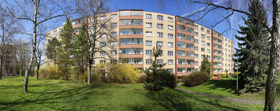 Block of flats. Renovated socialistic block of flats located in green neighbourhood royalty free stock image