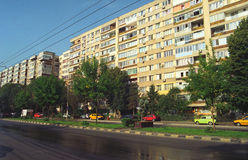 Block of flats and road. In Bucharest city. Film scan, visible grain royalty free stock images
