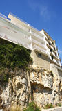 Block of flats on a rock Stock Photography