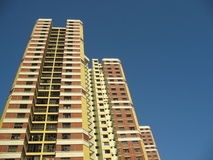 A block of Flats In Singapore. A block of HDB Flats found in Singapore against blue sky Royalty Free Stock Images