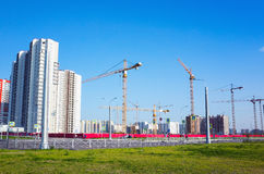 Block of flats under construction, working crane Royalty Free Stock Image