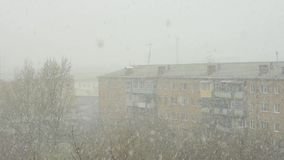 Block of flats under the snowstorm. In spring time stock video
