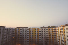 Block of flats vertical panorama. Color image of some flats in a block, at sunset Stock Image