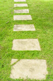 Block footpath on grass Royalty Free Stock Images