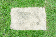 Block footpath on grass Stock Images
