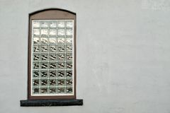 Block Glass Window in Stucco Wall Stock Image