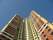 A block of HDB Flats In Singap. A block of HDB Flats found in Singapore against blue sky Royalty Free Stock Images