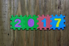 Block letters and number 2017 with wood background Stock Photo