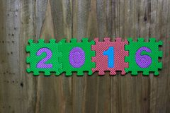 Block letters and numbers 2016 with wood background Stock Image