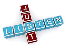 Block letters spelling just listen Stock Image