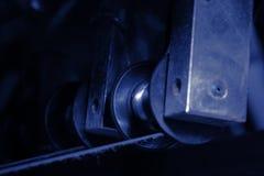Block med bältet som ett stycke av den industriella maskinen Arkivbilder