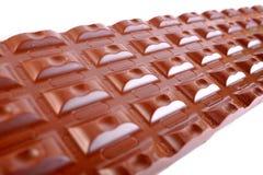 Block of milk chocolate. On white background Royalty Free Stock Photo