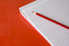 Block note and red pencil Royalty Free Stock Photography