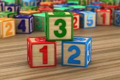 Block with number on wooden surface. 3D illustration.  Royalty Free Stock Images