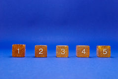 Block Numbers Isolated on Blue Royalty Free Stock Images