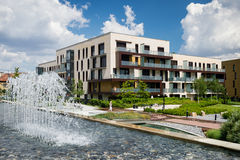 Free Block Of Flats In Public Park With Water Steam During Hot Summer Day Royalty Free Stock Image - 57703156