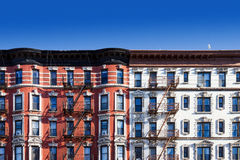 Block of old buildings in New York City with blue sky background. New York City block of old historic apartment buildings in the East Village of Manhattan, NYC Stock Image