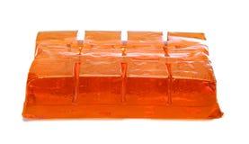 Block of orange jelly cubes Royalty Free Stock Photos