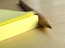 Block pad and pencil. Yellow block pad and pencil - detail Stock Photos