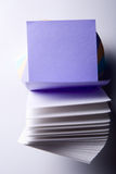 Block of paper for notes with a clean open-purple leaves Royalty Free Stock Images