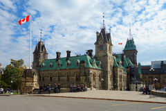 Block of Parliament Hill. Ottawa Canada built in the Victorian High Gothic style standing against the background of the cloudy sky Stock Image