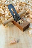 Block plane and shavings Royalty Free Stock Photos