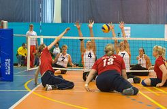 Block powerless. MOSCOW - MAY 11: Some players in action at 4 Open Moscow sitting volleyball match between the national team in 2014 Russia (red) and the Stock Images