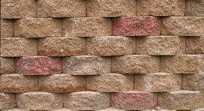 Block Retaining Wall. Multi-colored blocks on a retaining wall Stock Images