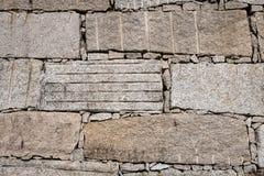 Block retaining wall made of big granite stones stock photo