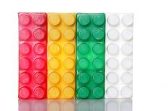 block som buidling över plastic white Royaltyfria Bilder