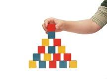 block som bygger barnhanden, gör royaltyfri foto