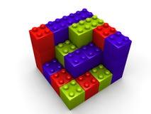 block som bygger lego arkivfoto