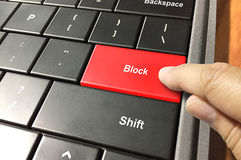 Block somebody. Picture of a computer keyboard showing block key with man's finger Stock Photo