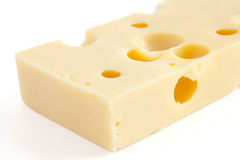 Block of swiss type cheese Royalty Free Stock Photos