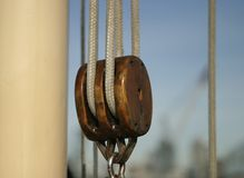 Block and Tackle. An old pulley on a sailboat. With many coats of old varnish, it virtually glows royalty free stock images