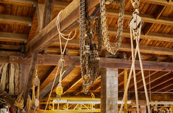 Block and Tackle in Boat Shop. Block and Tackle with chains used in a boat building workshop stock photography