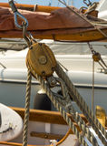 Block tackle detail. Close up of a block and tackle on a sailing boat in the port of La Ciotat. Copyspace royalty free stock photos