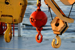Block and Tackle on dock. Close up of block and tackle on a crane by the waters edge Royalty Free Stock Photo
