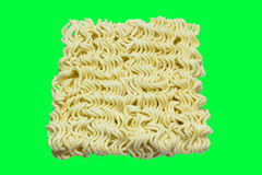 A block of uncooked Ramen Noodles Isolated on green screen Stock Photos