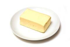 Block von Butter auf Platte Lizenzfreie Stockfotografie