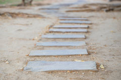 Block walk path. The Stone block walk path on soil with Depth Of Field Stock Photo