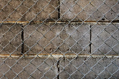 Block wall and net fence Royalty Free Stock Photography
